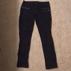 Navy blue jeans with zippers